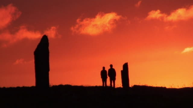 MS People standing at Ring of Brodgar at sunset / Orkney, Scotland, United Kingdom