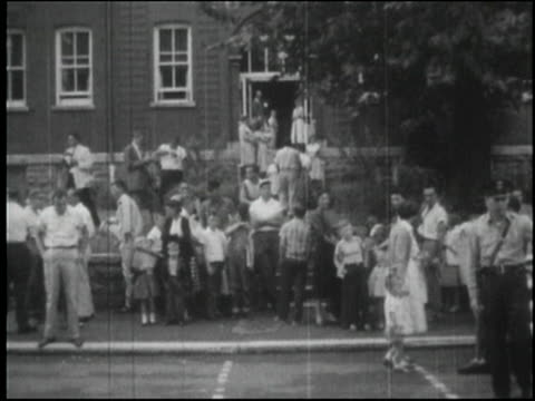 people standing in front of school to protest allowing african american children to attend traditionally white schools - segregation stock videos & royalty-free footage