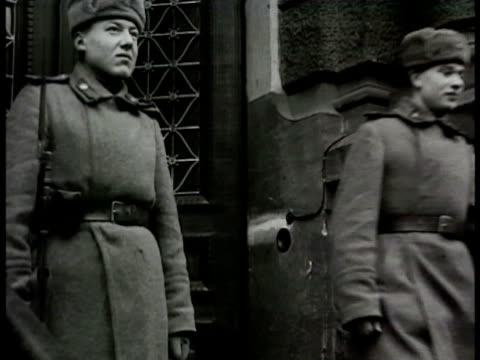 people standing in street groups some just walking soviet red army soldiers walking out of building red army officer sitting at desk communists... - 1948 stock videos and b-roll footage