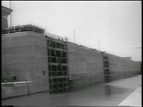 b/w 1959 people standing on edge of canal/lock of st lawrence seaway / canada / newsreel - 1959 stock videos & royalty-free footage