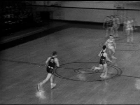 people standing on median, men walking up steps of indoor athletic building , sign above doorway. basketball: game play, yale in dark uniforms, fans.... - median nerve stock videos & royalty-free footage