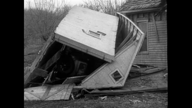 vídeos y material grabado en eventos de stock de / people standing on the rubble created from the seattle waterfront storm / houses destroyed, people looking confused, debris everywhere / cars on... - 1934