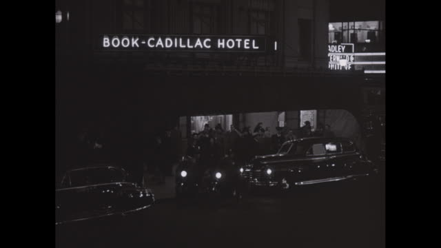 WS People standing outside Book Cadillac Hotel at night / Detroit, Michigan, United States