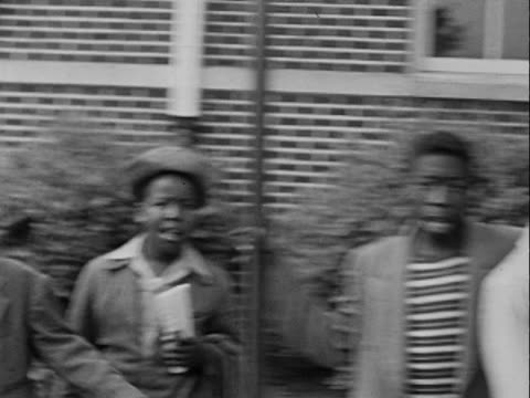1950 montage b/w people standing outside building with young man in graduation gown/ greenwood, tulsa, oklahoma, usa - graduation gown stock videos and b-roll footage