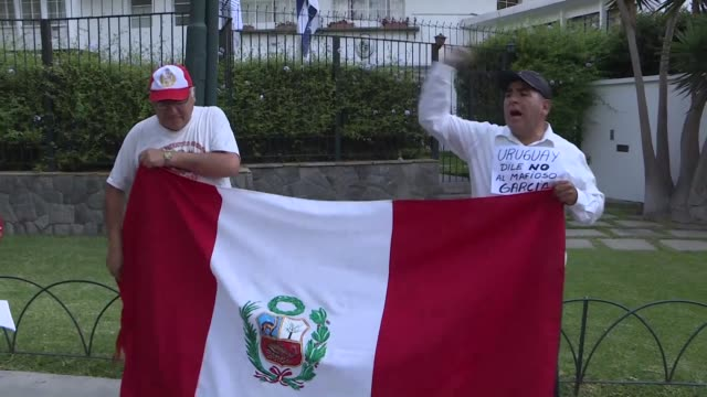 stockvideo's en b-roll-footage met people start to gather in front of the uruguay ambassador's house in peru's capital after former peruvian president alan garcia reportedly sought... - former