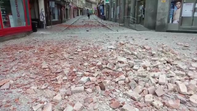 people stay on a street after a 53 magnitude earthquake hit zagreb croatia on march 22 2020 a 53 magnitude earthquake struck the croatian capital of... - zagreb stock videos & royalty-free footage