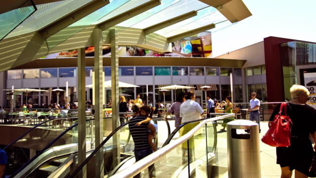 vídeos de stock e filmes b-roll de ws t/l people stepping off escalator on to upper level of santa monica place food court and restaurant area / santa monica, california, usa   - shopping centre