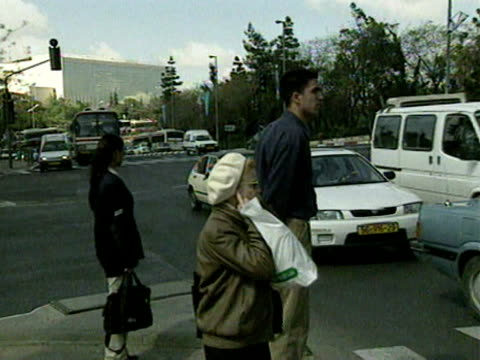 People stop and observe a two minute silence on the streets of Jerusalem to mark Holocaust Day 1998