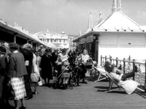 people stroll along brighton's palace pier - outdoor chair stock videos & royalty-free footage