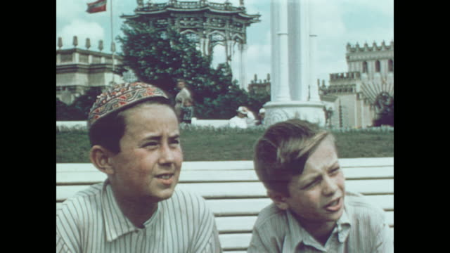 1959 people stroll the exhibits and vendors of the pavilion in downtown moscow - moscow russia stock videos & royalty-free footage