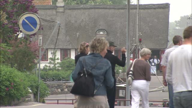 People stroll through Samso, Denmark.