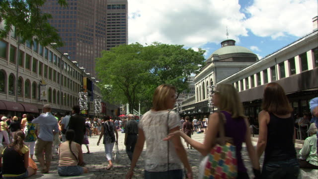 ws people strolling in area between quincy market and south market in faneuil hall marketplace / boston, massachusetts, usa - pedestrian zone stock videos & royalty-free footage