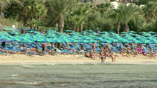 stockvideo's en b-roll-footage met ms people strolling on beach / agia napa, cyprus - repubiek cyprus