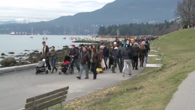 MS People strolling on path near beach / Vancouver, British Columbia, Canada