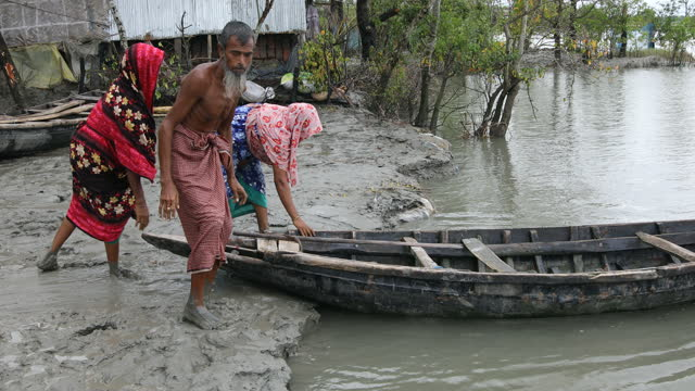 people suffers in the coastal area in bangladesh on september 24, 2020. bangladesh is one of the country's most vulnerable to the effects of climate... - natural disaster stock videos & royalty-free footage