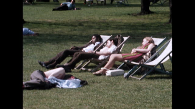 people sunbathe in regent's park, london; 1968 - outdoor chair stock videos & royalty-free footage