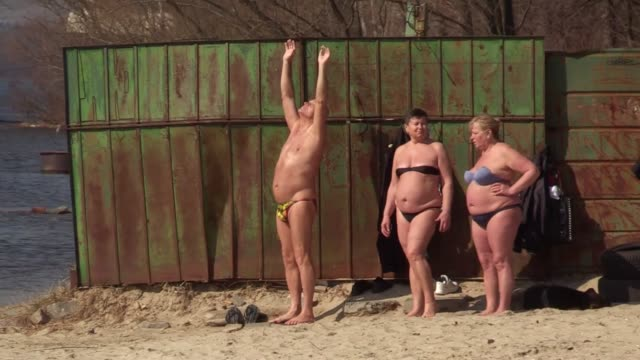 People sunbathes for the first time of the year on a bank of the Dnieper River in Kiev Ukraine 22 March 2017