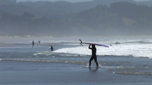 people surfing in oregon coast united states - oregon coast stock videos & royalty-free footage