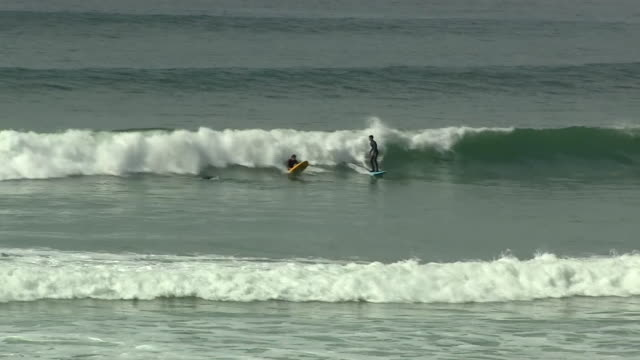 people surfing off the coast of cornwall - power in nature stock videos & royalty-free footage
