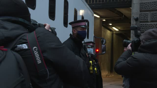 people surround one a van arrives at the old bailey on january 4, 2021 in london, england. district judge vanessa baraitser will issue her decision... - crime or recreational drug or prison or legal trial stock videos & royalty-free footage