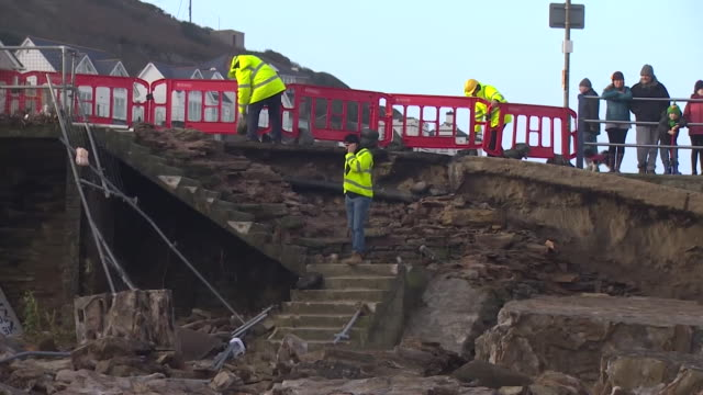 people survey the damage to a twentymetre section of portreath's harbour wall after it has been damaged by storm eleanor january 2018 nnbz198k... - coastline stock videos & royalty-free footage