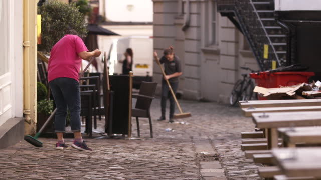 people sweep up the streets around windsor castle in preparation for the royal wedding of prince harry and meghan markle in windsor england - cobblestone stock videos & royalty-free footage