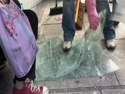 people sweeping streets in leeds after the riot august 2011 - リーズ点の映像素材/bロール