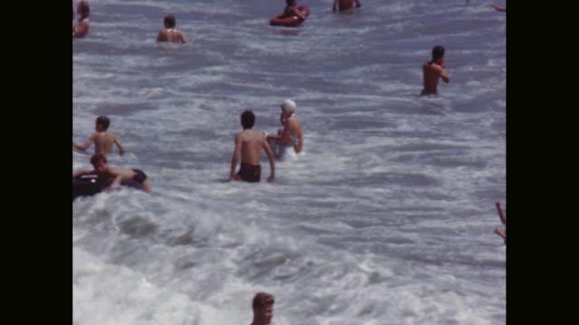 MS people swimming and enjoying on beach / Avila Beach, California, United States