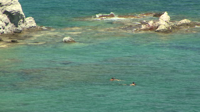 WS People swimming and snorkeling on sea by beach / Akamas, Cyprus
