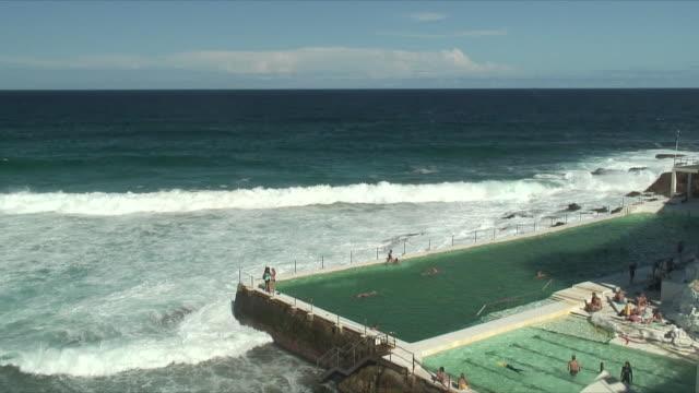 WS HA People swimming at Icebergs pool in Bondi Beach, Sydney, New South Wales, Australia