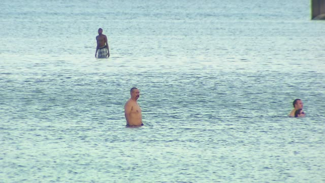 People Swimming In Lake Michigan