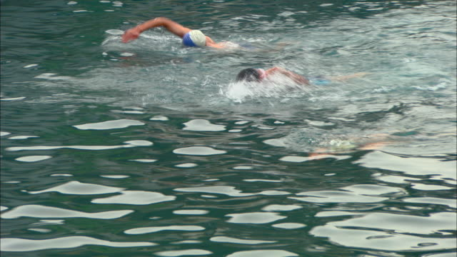 ms people swimming in outdoor public pool, jinan, shandong, china - water sports equipment stock videos and b-roll footage