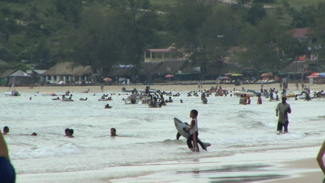 ws people swimming in sea, sihanouksville, cambodia - cambodia stock videos & royalty-free footage