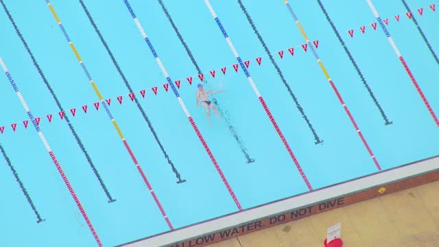 ws aerial zi zo ts people swimming in swimming pool / cranbourne, melbourne, australia - utebassäng bildbanksvideor och videomaterial från bakom kulisserna