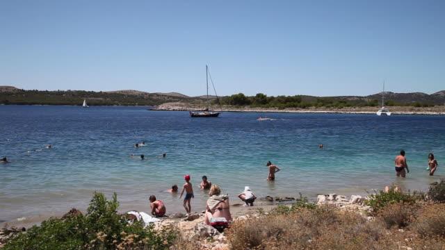 People swimming in the Lavdara island, Kornati National Park
