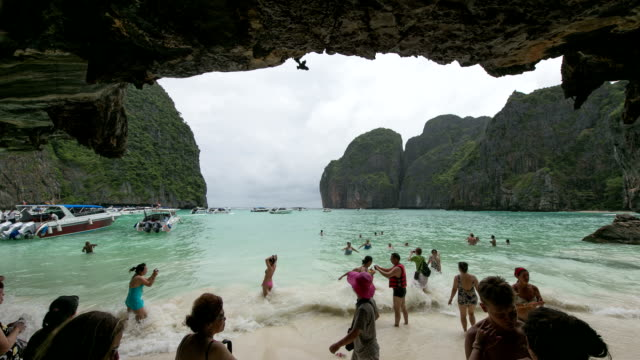 people swimming on the beach in phuket, thailand - phuket stock videos & royalty-free footage