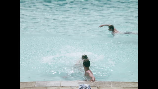 People swimming, playing in pool