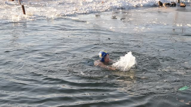 People swims in famous Houhai Lake in cold winter on January 18 2016 in Beijing China Temperatures plummet to minus 10 degrees as cold wave hits...