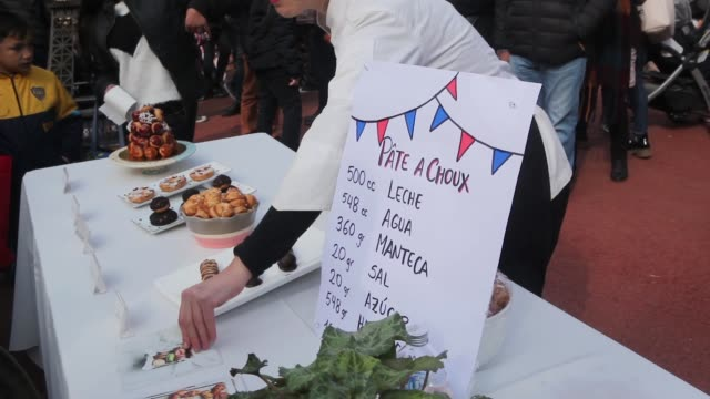 people take a stroll and buy food during the celebration of the 230th anniversary of the french revolution as part of the french market 'le... - french revolution stock videos & royalty-free footage