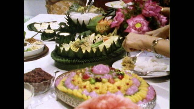 people take food from colourful thai buffet in restaurant; 1989 - lunch stock videos & royalty-free footage