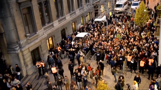 people take part in a candle light vigil for the victims of the paris attacks in the molenbeek district of brussels, belgium on november 18, 2015. - 2015 stock videos & royalty-free footage