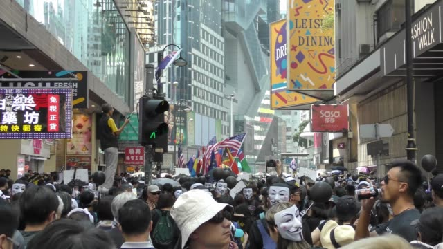 people take part in a demonstration the streets of hong kong on october 1 as the city observes the national day holiday to mark the 70th anniversary... - times square causeway bay stock videos & royalty-free footage
