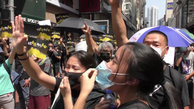 people take part in a demonstration the streets of hong kong on october 1 as the city observes the national day holiday to mark the 70th anniversary... - communist flag stock videos & royalty-free footage