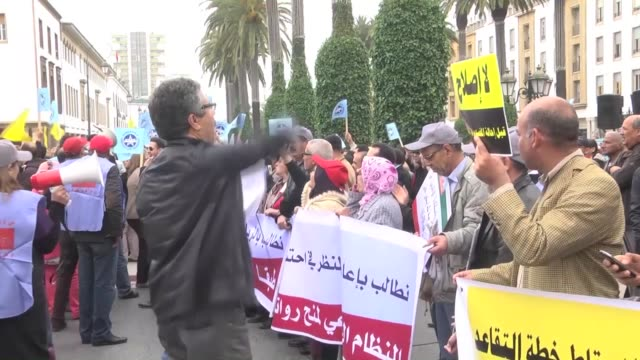 people take part in a demonstration to protest government's retirement law reforms in front of the parliament building in rabat, morocco on march 30,... - parliament building stock videos & royalty-free footage
