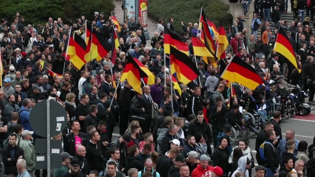 people take part in a gathering organized by the right-wing pro chemnitz movement to commemorate the death of chemnitz local daniel hillig on... - demonstrant stock-videos und b-roll-filmmaterial