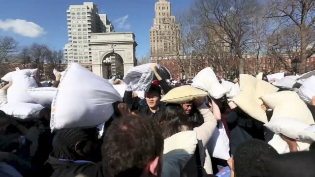 people take part in a giant pillow fight at washington square on annual 'international pillow fight day' on april 4 2015 in new york mass public... - pillow fight stock videos & royalty-free footage