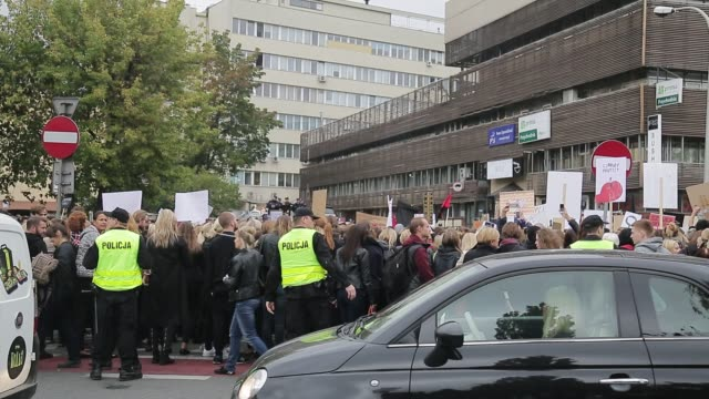 people take part in a nationwide strike and demonstration to protest against a legislative proposal for a total ban of abortion on october 3 2016 in... - streik stock-videos und b-roll-filmmaterial