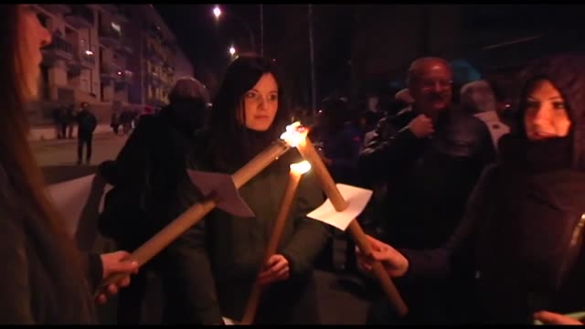 People take part in a torchlight procession for earthquake victims in L'Aquila Italy April 5 2017 on the eve of the eigth anniversary of the...