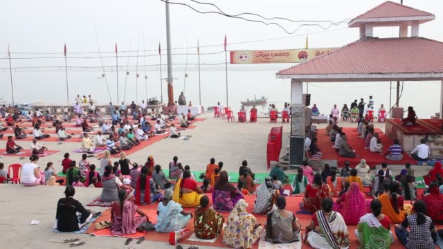 People take part in a yoga session at Assi Ghat by the banks of the Ganges river in Varanasi Uttar Pradesh India on Saturday Oct 29 2017