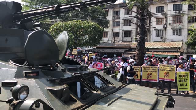 people take part in an anti-coup protest amid the presence of armoured military vehicles and tatmadaw soldiers on february 15, 2021 near the central... - army stock videos & royalty-free footage